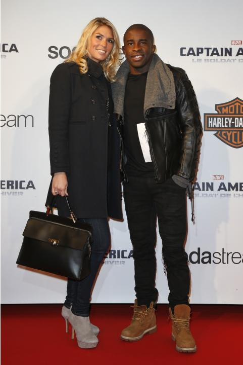 "Lille's soccer player Mavuba and wife Elodie pose at the French premiere of the film ""Captain America: The Winter Soldier"" in Paris"