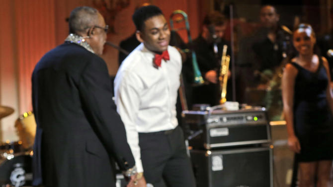 """President Barack Obama, center seated, looks over toward his daughter Sasha, as singers Sam Moore, left, and Joshua Ledet, right, perform on stage during the """"In Performance at the White House"""" in the East Room of the White House in Washington, Tuesday, April 9,  2013, a program for a celebration of Memphis Soul Music. (AP Photo/Pablo Martinez Monsivais)"""