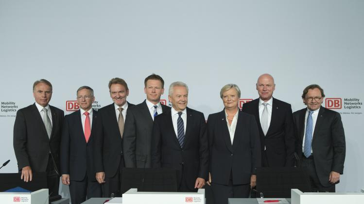 Chairman of German Railway Deutsche Bahn Grube and the members of the board pose together at the company's half year news conference in Berlin