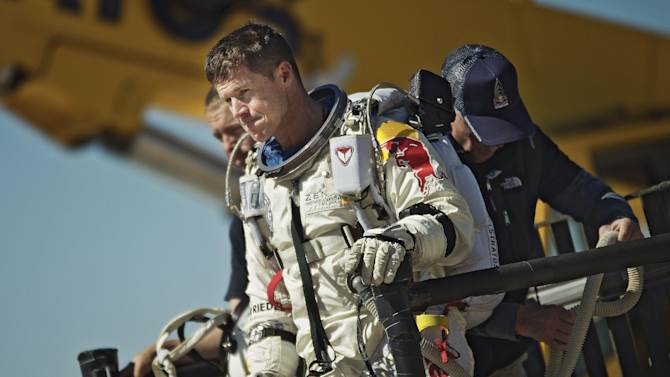 """FILE - This photo provided by Red Bull Stratos shows pilot Felix Baumgartner of Austria reacting after his mission was aborted in Roswell, N.M., on Oct. 9, 2012.  on Sunday, Oct. 14, 2012,  mission control officials declared a """"weather hold"""" until 8:15 a.m. MDT, and said that inflation of the balloon wouldn't begin until after that hold is lifted. Earlier, the launch team said they were aiming for the three-hour ascent to begin Sunday at 8 a.m. The jump was postponed twice last week because of high winds. (AP Photo/Red Bull Stratos, Joerg Mitter)"""