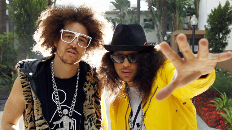 FILE - In this June 22, 2011 file photo, Redfoo, left, and SkyBlu, from the musisc group LMFAO, pose for a portrait in Los Angeles. (AP Photo/Matt Sayles, file)