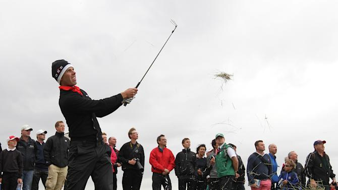 South Africa's Charl Schwartzel plays a shot out of the rough on the 13th hole during a practice round ahead of the British Open Golf Championship at Royal St George's golf course in Sandwich, England, Wednesday, July 13, 2011. (AP Photo/Tim Hales)