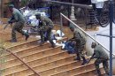 Kenya Defence Forces soldiers take their position at the Westgate shopping centre in Nairobi