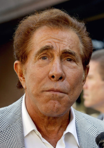 "FILE - This Sept. 7, 2012 file photo shows casino mogul Steve Wynn arriving at court for his slander trial in Los Angeles. Wynn on Tuesday Sept. 11, 2012, was awarded $20 million in punitive damages against ""Girls Gone Wild"" creator, Joe Francis in his defamation lawsuit. (AP Photo/Nick Ut)"