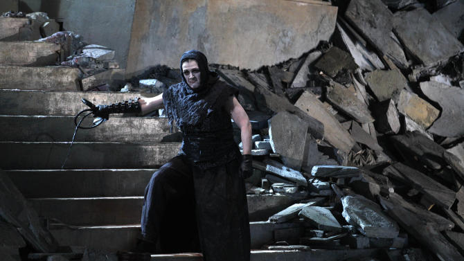 """In this photo taken Tuesday, Oct. 2, 2012, in Chicago, Elizabeth Burne as the Overseer performs during the first act of a dress rehearsal of the Lyric Opera of Chicago's new production of """"Elektra."""" (AP Photo/M. Spencer Green)"""