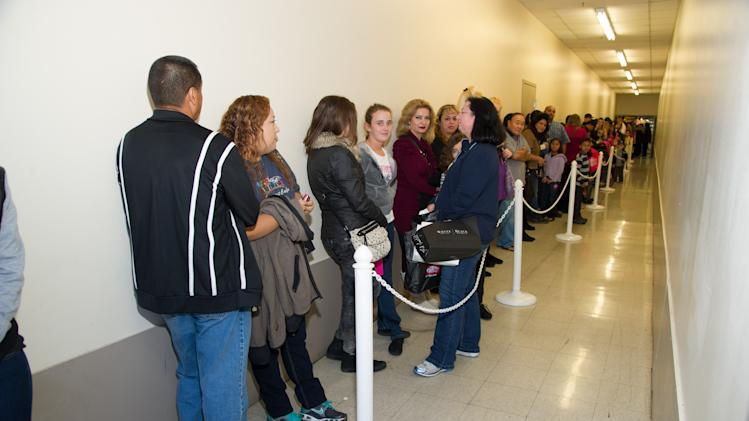 "Fans wait in line for Nicole ""Snooki"" Polizzi, as she hosts a meet and greet at a Perfumania for the release of her second fragrance, ""Snooki Couture"" on Wednesday, January 9, 2013, in Las Vegas, NV (Photo by Al Powers/Powers Imagery/Invision/AP)"