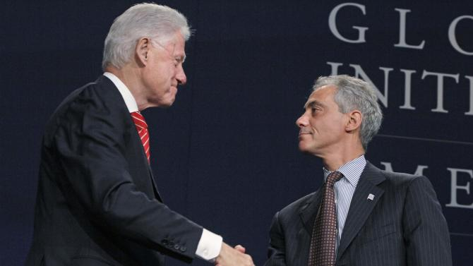Former President Bill Clinton shakes hands with Chicago Mayor Rahm Emanuel at the opening of the The Clinton Global Initiative America meeting, Wednesday, June 29, 2011, in Chicago. More than 700 leaders from businesses, nonprofit, and all levels of government are participating in the the two-day meeting which is focusing exclusively on driving job creation and economic growth in the United States.  (AP Photo/M. Spencer Green)