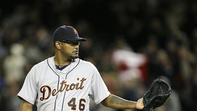 Detroit Tigers pitcher Jose Valverde waits for the ball after giving up a two-run home run to New York Yankees' Ichiro Suzuki , rear, in Game 1 of the American League championship series Saturday, Oct. 13, 2012, in New York. (AP Photo/Matt Slocum)