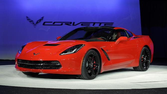 FILE - In this Jan. 14, 2013 file photo, the 2014 Chevrolet Corvette Stingray is revealed at media previews for the North American International Auto Show in Detroit. GM says a base model of the Corvette Stingray will start at just under $52,000, including a $995 shipping charge, when the all-new version goes on sale this summer. (AP Photo/Paul Sancya, File)