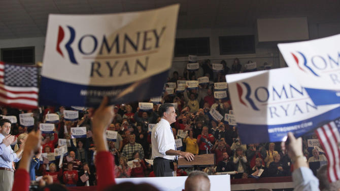 Republican presidential candidate and former Massachusetts Gov. Mitt Romney and vice presidential candidate Rep. Paul Ryan, R-Wis., left, campaign at the Veterans Memorial Coliseum, Marion County Fairgrounds, in Marion, Ohio, Sunday, Oct. 28, 2012. (AP Photo/Charles Dharapak)