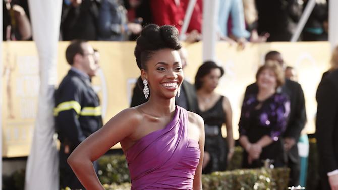Teyonah Parris arrives at the 19th Annual Screen Actors Guild Awards at the Shrine Auditorium in Los Angeles on Sunday Jan. 27, 2013. (Photo by Todd Williamson/Invision for The Hollywood Reporter/AP Images)