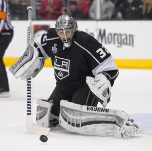 Los Angeles Kings goalie Jonathan Quick makes a saves against the New York Rangers during the first period of Game 2 in the NHL Stanley Cup Final hockey series in Los Angeles, Saturday, June 7, 2014. (AP Photo/Mark J. Terrill)