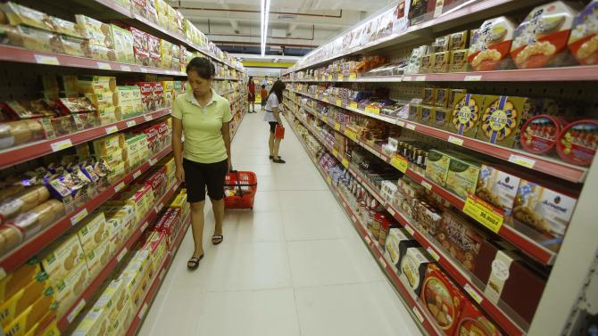 A woman pulls a cart at a supermarket in Hanoi