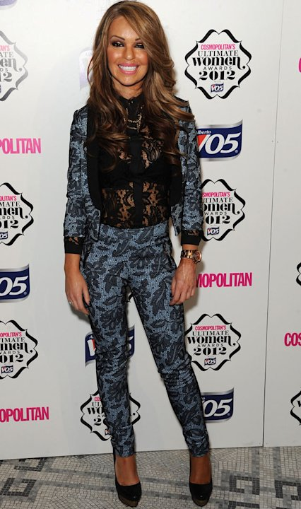 Katie Piper looked super stylish in a patterened trouser suit and lace top. Copyright [Getty]