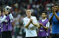 Germany's Bastian Schweinsteiger applauds the crowd at the end his side's Euro 2012 semi-final defeat to Italy in Warsaw on June 28, 2012. Bayern Munich head to China this weekend without Schweinsteiger and Philipp Lahm, club coach Jupp Heynckes announced on Friday