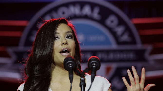 Presidential Inaugural Committee Co-Chair Eva Longoria gestures as she participates in the opening ceremony for the National Day of Service as part of the 57th Presidential Inaugural festivities, Saturday, Jan. 19, 2013, in Washington.   (AP Photo/Steve Helber)