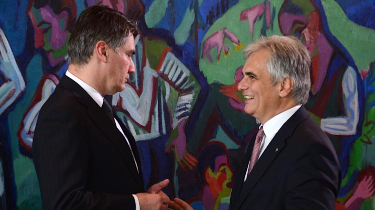 """Austrian Chancellor Faymann talks with Croatian Prime Minister Milanovic during the """"West Balkan Conference"""" at the chancellery in Berlin"""