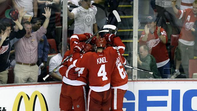 Detroit Red Wings players celebrate Detroit Red Wings center Gustav Nyquist's, of Sweden, goal against the Chicago Blackhawks during the second period of an NHL hockey Stanley Cup playoffs Western Conference semifinal game in Detroit, Monday, May 20, 2013. (AP Photo/Paul Sancya)