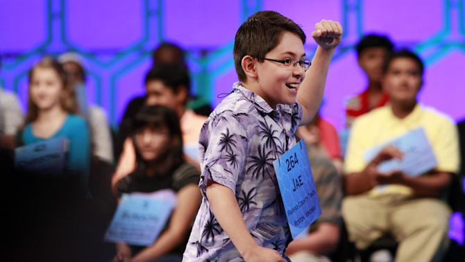 Jae Canetti, 10, of Fairfax, Va., celebrates after spelling a word correctly during the fourth round of the semifinals at the National Spelling Bee in Oxon Hill, Md., Thursday, May 31, 2012.  (AP Photo/Jacquelyn Martin)