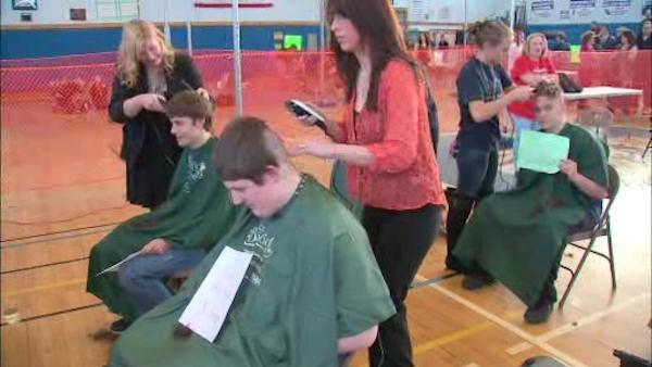Students shave heads for cancer research money