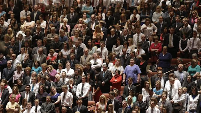 People gather inside the Conference Center during the 183rd Annual General Conference of The Church of Jesus Christ of Latter-day Saints Saturday, April 6, 2013, in Salt Lake City.  The Church of Jesus Christ of Latter-day Saints is planning to build two new temples in Rio de Janeiro and Cedar City, Utah, the president of the Mormon church announced Saturday. Thomas S. Monson made the announcement in his opening address to more than 100,000 members of the church who've gathered in Salt Lake City for the church's 183rd semi-annual general conference. (AP Photo/Rick Bowmer)
