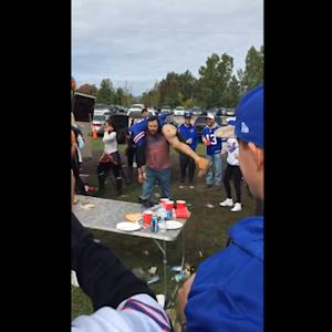 Bills fan slams buddy through table while tailgating