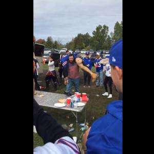Bills fan slams buddy through table while tailgating