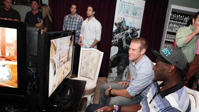 COMMERCIAL IMAGE - In this photograph taken by AP Images for Ubisoft, fellow NFL Rookies, Justin Blackmon, right, and Ryan Tannehill play their favorite video game, Ubisoft's Ghost Recon: Future Soldier in Los Angeles on Thursday, May 17, 2012.  (Casey Rodgers / AP Images for Ubisoft)