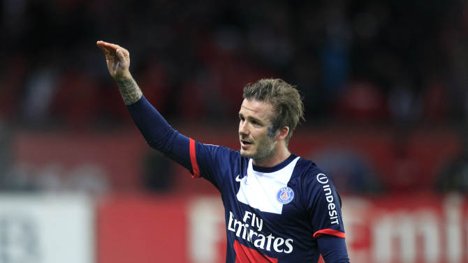 Paris Saint Germain's midfielder David Beckham from England, waves as he leaves the field, during his French League One soccer match against Brest, at the Parc des Princes stadium, in Paris, Saturday, May 18, 2013. Paris Saint-Germain hopes to strike a deal with David Beckham in the next two weeks in which the former England captain will work with the French club after retirement, possibly in an ambassadorial role. (AP Photo/Thibault Camus)