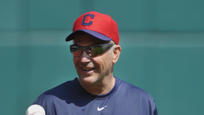 """Actor Kevin Costner prepares to take warm-ups with the Cleveland Indians before their game with the Minnesota Twins in Cleveland, Sunday, June 23, 2013. Costner has been in Cleveland filming scenes for the movie """"Draft Day""""(AP Photo/Phil Long)"""