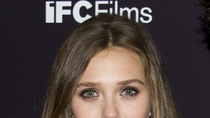"FILE - This Sept. 10, 2012 photo shows Elizabeth Olsen at the ""Liberal Arts"" premiere in New York. Olsen will soon be a star-crossed lover _ she'll star in an off-Broadway version of Shakespeare's ""Romeo & Juliet."" Classic Stage Company said Thursday that the younger sister of Mary-Kate and Ashley Olsen will help will kick off their 2013/2014 season. (Photo by Charles Sykes/Invision/AP, file)"
