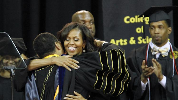 First lady Michelle Obama hugs Presidential Medal of Excellence recipient Freeman A. Hrabowski III during the commencement ceremony for Bowie State University, Friday, May 17, 2013, at the University of Maryland in College Park, Md. (AP Photo/Ann Heisenfelt)