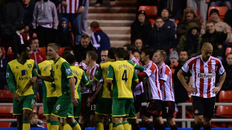 Sunderland's Brown is sent off against Norwich City by referee Atkinson during English Premier League soccer match in Sunderland