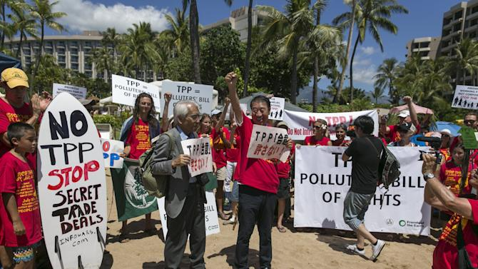 Former Japanese Agriculture Minister Masachiko Yamada leads a protest against the Trans-Pacific Partnership meeting (TPP) in Lahaina, Maui