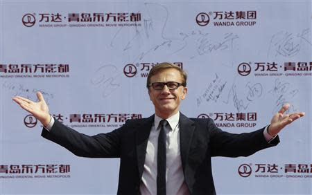 Austrian-German actor Christoph Waltz gestures to the media as he arrives for the launch ceremony of the Qingdao Oriental Movie Metropolis on the outskirts of Qingdao
