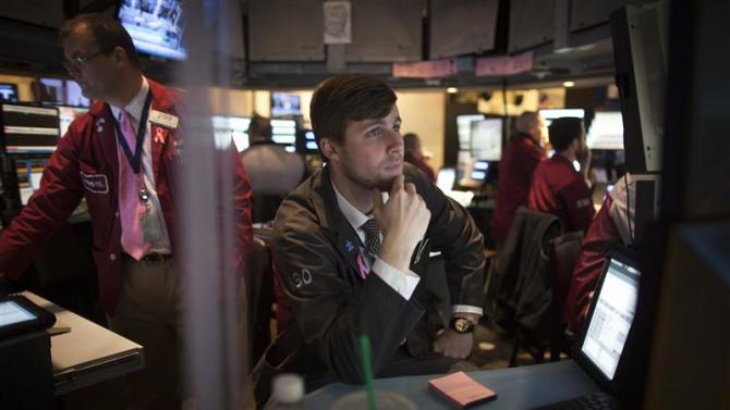 Traders work on the floor of the New York Stock Exchange during the opening bell in New York