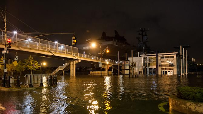 FILE - This Monday, Oct. 29, 2012, file photo provided by Dylan Patrick shows flooding along the Westside Highway near the USS Intrepid, background center, as Superstorm Sandy moves through the area. NASA spokeswoman Lisa Malone said Friday, Nov. 2, 2012,  officials with the Intrepid Sea, Air and Space Museum told the space agency the space shuttle Enterprise suffered minor damage during Superstorm Sandy which struck on Monday. (AP Photo/Dylan Patrick) MANDATORY CREDIT: DYLAN PATRICK