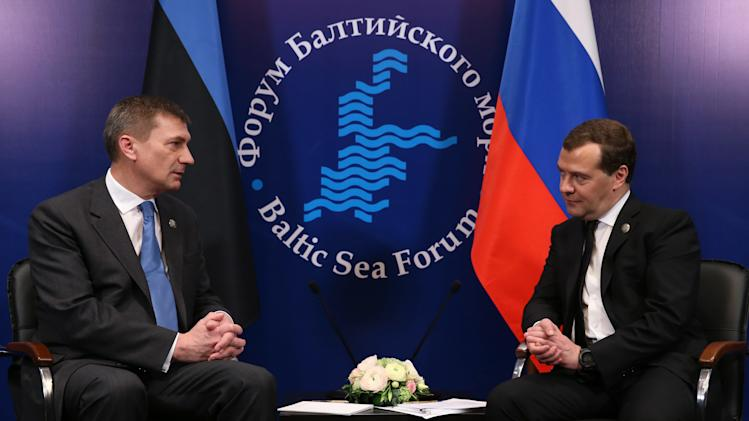 Russian Prime Minister Dmitry Medvedev, right, and Estonian Prime Minister Andrus Ansip meet during the Baltic Sea Forum session in St. Petersburg, Russia, Friday, April 5, 2013. (AP Photo/RIA Novosti, Yekaterina Shtukina, Government Press service)