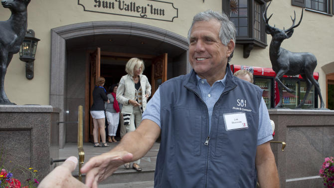 FILE - In this Thursday, July 7, 2011 file photo, Les Moonves, president and CEO of CBS Corporation, greets a member of the media at the Sun Valley Inn for the 2011 Allen and Co. Sun Valley Conference in Sun Valley, Idaho. Moonves is one of the top 10 highest paid CEOs at publicly held companies in America last year, according to calculations by Equilar, an executive compensation data firm, and The Associated Press. The Associated Press formula calculates an executive's total compensation during the last fiscal year by adding salary, bonuses, perks, above-market interest the company pays on deferred compensation and the estimated value of stock and stock options awarded during the year. (AP Photo/Julie Jacobson, File)