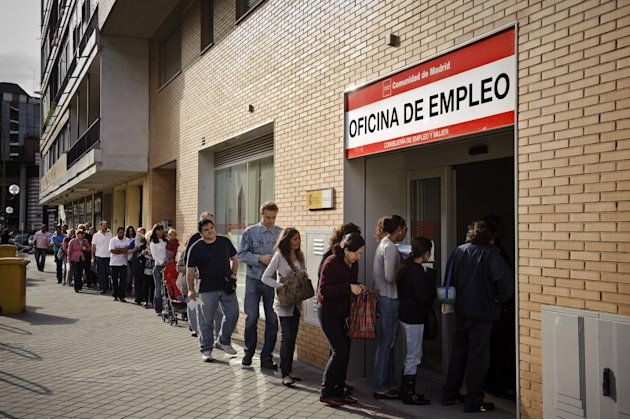 FILE - In this May, 28, 2010, file photo, people line up to enter a government job center in Madrid. According to a report released by the Associated Press in January 2013, of the 17 European countrie