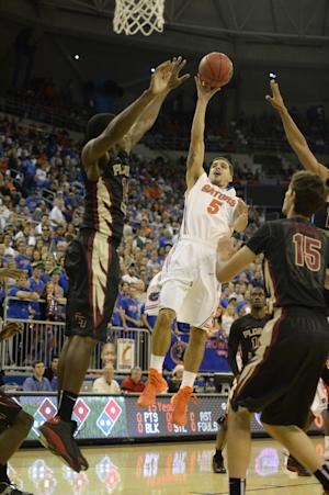 Finney-Smith lifts No. 15 Florida over FSU 67-66