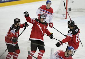 Canada, Russia advance to ice hockey worlds final