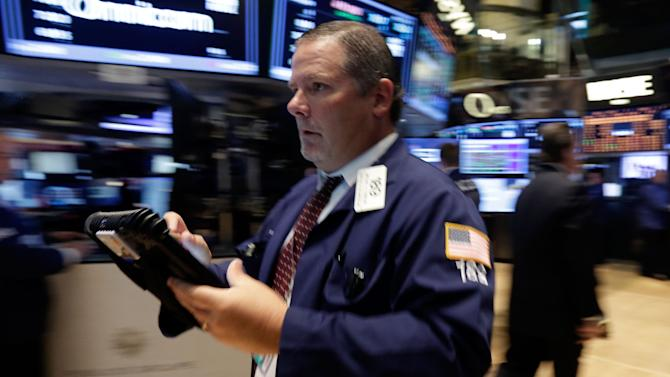 This July 29, 2013 photo, Trader Michael Conlon rushes across the floor of the New York Stock Exchange. U.S. stock futures rose modestly Tuesday, July 30, 2013, with most investors taking a wait-and-see approach ahead of a two-day Fed policy meeting. (AP Photo/Richard Drew)
