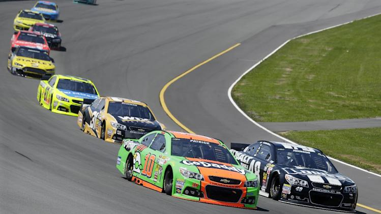 Danica Patrick (10) races with Jimmie Johnson (48) during the NASCAR Sprint Cup series Pocono 400 auto race, Sunday, June 8, 2014, in Long Pond, Pa