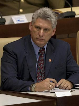 Newly appointed Cuba's Vice President Miguel Diaz-Canel participates in the closure session of the National Assembly in Havana, Cuba, Sunday, Feb. 24, 2012. Raul Castro accepted a new five-year term that will be, he said, his last as Cuba's president and tapped rising star Diaz-Canel, 52, as vice-president and first in the line of succession. (AP Photo/Ramon Espinosa)