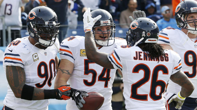 Chicago Bears middle linebacker Brian Urlacher (54) celebrates with Julius Peppers (90) and Tim Jennings (26) after Urlacher returned an interception for a touchdown against the Tennessee Titans in the first quarter of an NFL football game on Sunday, Nov. 4, 2012, in Nashville, Tenn. (AP Photo/Joe Howell)