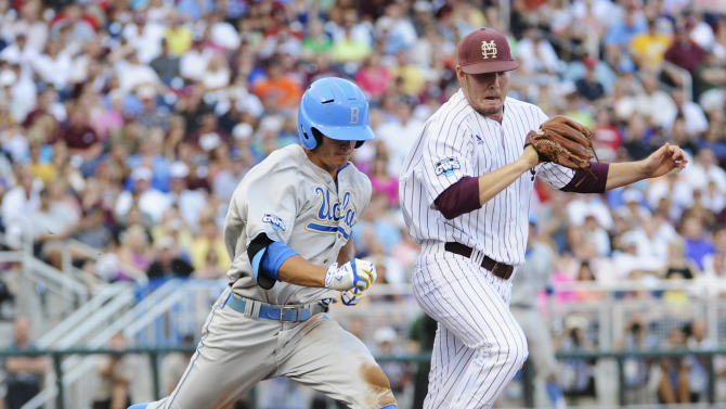 Mississippi State pitcher Chad Girodo, right, and UCLA base runner Kevin Kramer race for first base in the second inning of Game 1 of the NCAA College World Series best-of-three finals, Monday, June 24, 2013, in Omaha, Neb. Kramer was out on the play. (AP Photo/Francis Gardler)