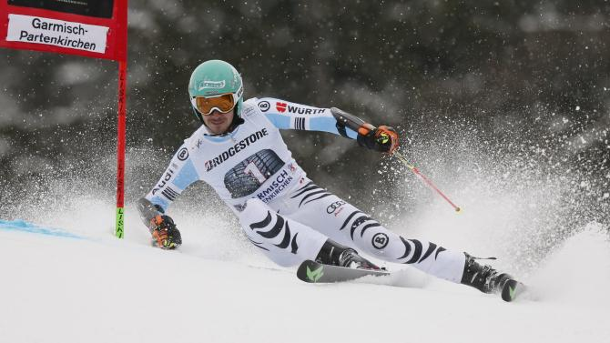 Neureuther of Germany clears gate during men's Alpine Skiing World Cup giant slalom in Garmisch-Partenkirchen