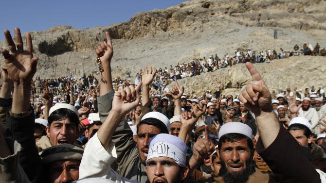 Afghans shout slogans during anti-US protest over burning of Qurans at a military bass in Afghanistan, in Ghani Khail, east of Kabul Friday, Feb. 24,2012. (AP Photo/Rahmat Gul)