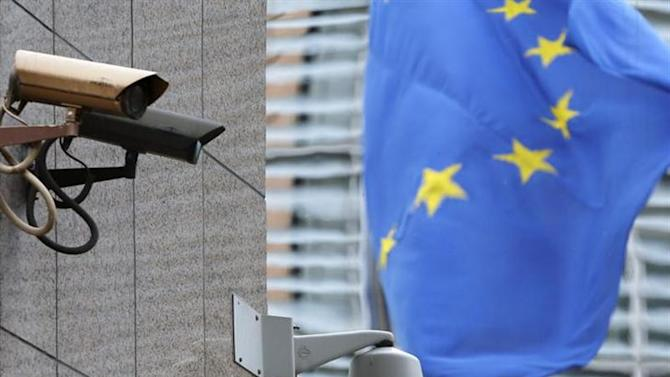 Security cameras are seen near the main entrance of the European Union Council building in Brussels July 1, 2013. REUTERS/Francois Lenoir/Files